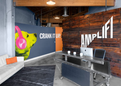 AmpliFi Advertising headquarters welcome wall